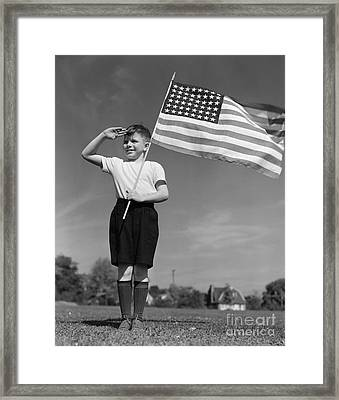 Boy Holding American Flag & Saluting Framed Print by H. Armstrong Roberts/ClassicStock