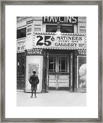 Boy In Front Of A Movie Theater Showing Framed Print by Everett