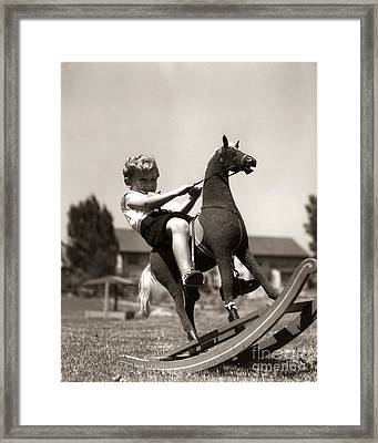 Boy On Rocking Horse, C.1930s Framed Print by H. Armstrong Roberts/ClassicStock