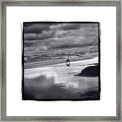 Boy On Shoreline Framed Print by Steve Gadomski