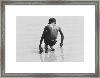 Boy Playing In The Sand At Coney Island Framed Print by Nat Herz