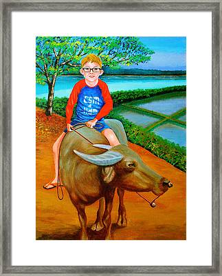 Boy Riding A Carabao Framed Print by Cyril Maza