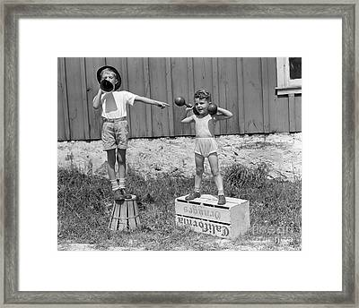 Boys Playing Carnival Strongman Framed Print by H. Armstrong Roberts/ClassicStock