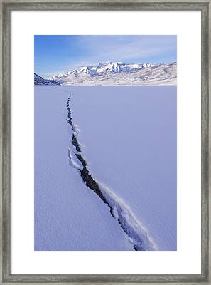 Breaking Ice Framed Print by Chad Dutson