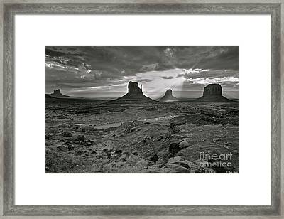 Breaking Light At Monument Valley - Black And White Framed Print by Brian Stamm