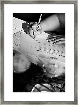 Bride Signing Name On Marriage Register Contract Framed Print by Jorgo Photography - Wall Art Gallery