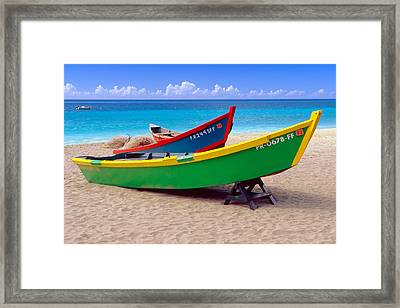 Brightly Painted Fishing Boats On A Caribbean Beach Framed Print by George Oze