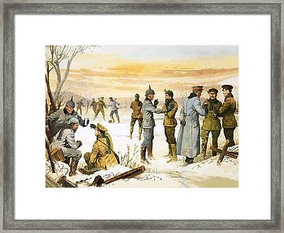 British And German Soldiers Hold A Christmas Truce During The Great War Framed Print by Angus McBride