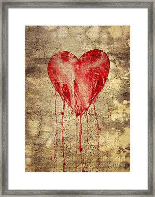 Broken And Bleeding Heart On The Wall Framed Print by Michal Boubin