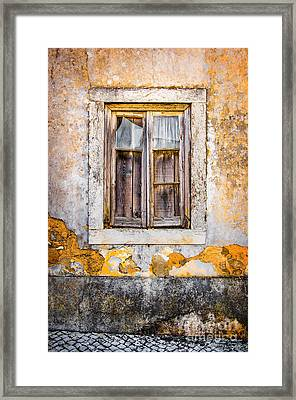 Broken Window Framed Print by Carlos Caetano