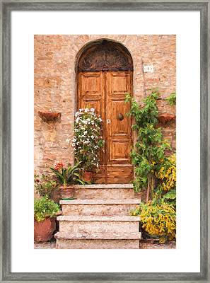 Brown Door Of Tuscany Framed Print by David Letts
