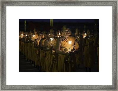 Buddhist Monks At Wat Dhamma Sunset 3 Framed Print by David Longstreath