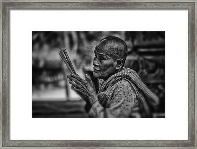 Buddhist Nun Prays Framed Print by David Longstreath
