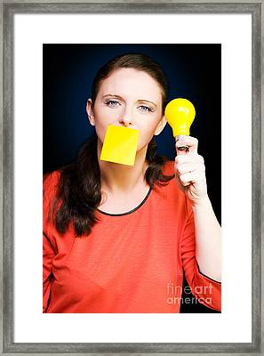 Business Woman With Idea Holding Yellow Light Bulb Framed Print by Jorgo Photography - Wall Art Gallery