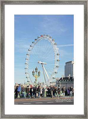 Bustling Past The Eye London Framed Print by Terri Waters