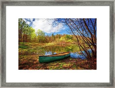 Canoe At Lakeside Framed Print by Debra and Dave Vanderlaan