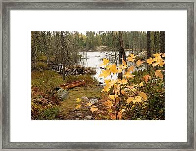 Canoe At Little Bass Lake Framed Print by Larry Ricker