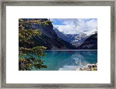 Canoe On Lake Louise Framed Print by Larry Ricker