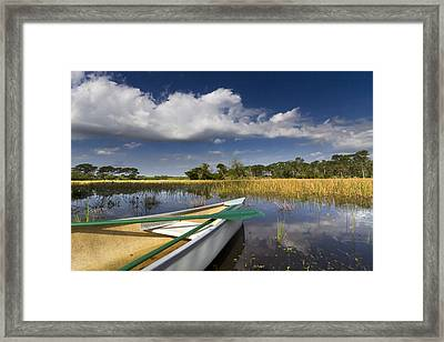 Canoeing In The Everglades Framed Print by Debra and Dave Vanderlaan