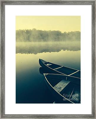 Canoes On Lake Framed Print by Pd