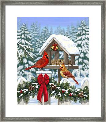 Cardinals Christmas Feast Framed Print by Crista Forest