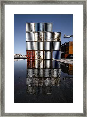 Cargo Containers Reflecting On Large Puddle IIi Framed Print by Marco Oliveira