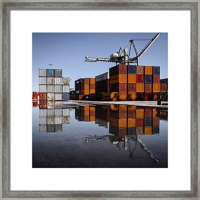 Cargo Containers Reflecting On Large Puddle Framed Print by Marco Oliveira