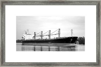 Cargo Ship On River Framed Print by Olivier Le Queinec