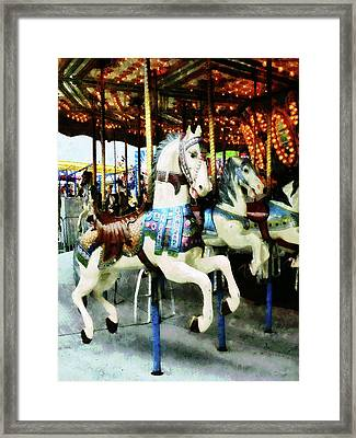 Carousel Horses Framed Print by Susan Savad