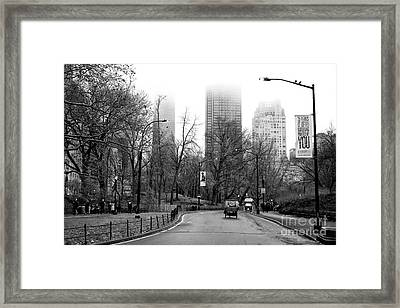 Carriage Ride On Center Drive Framed Print by John Rizzuto