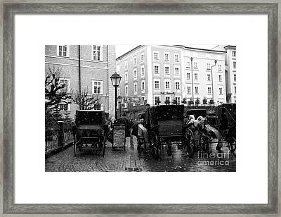 Carriages In Salzburg Framed Print by John Rizzuto
