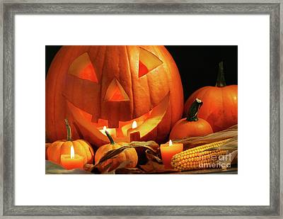 Carved Pumpkin With Candles Framed Print by Sandra Cunningham