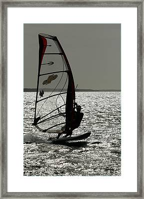 Catch The Wind Framed Print by Dan Leffel