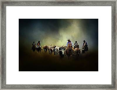 Cattle Drive At Dawn Framed Print by David and Carol Kelly