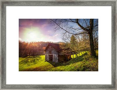 Celebrating Sunset Framed Print by Debra and Dave Vanderlaan