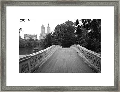 Central Park Bow Bridge With The San Remo Framed Print by Christopher Kirby