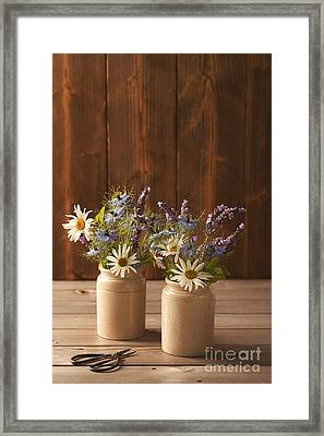 Ceramic Pots Filled With Flowers Framed Print by Amanda Elwell