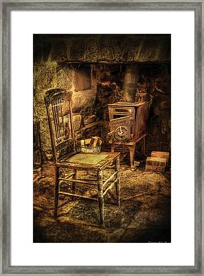 Chair - The Chair And The Stove Framed Print by Mike Savad
