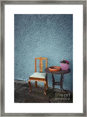 Chair And Iron Table Framed Print by Carlos Caetano