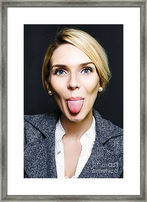Cheeky Business Woman Sticking Out Tongue Framed Print by Jorgo Photography - Wall Art Gallery