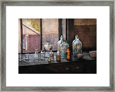 Chemist - Bottles Framed Print by Mike Savad