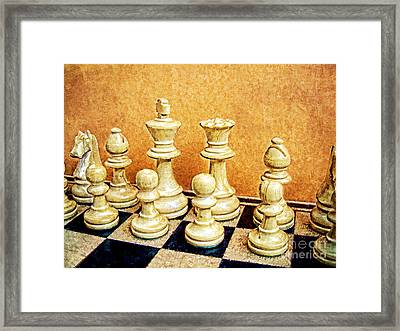 Chess Pieces On Board Framed Print by Helen  Bobis