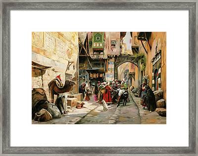 Chiacchiere Al Mercato Framed Print by Guido Borelli
