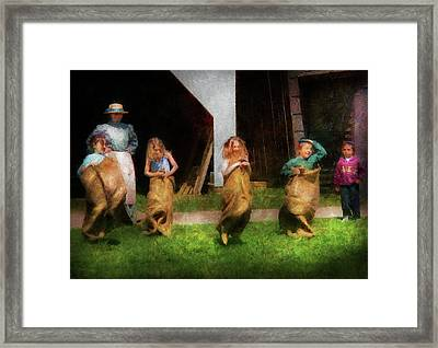 Children - The Sack Race  Framed Print by Mike Savad