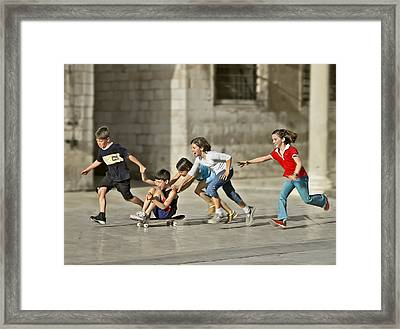 Children Playing In Dubrovnik Framed Print by Herbert A. Franke