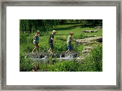 Children Playing In The Deer Lake Riffles Framed Print by Garry McMichael