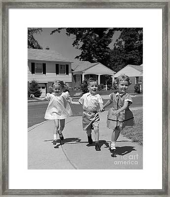 Children Skipping Down Sidewalk, C.1960s Framed Print by H. Armstrong Roberts/ClassicStock