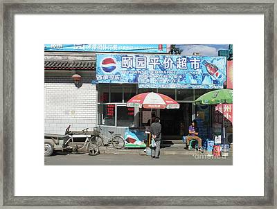 Chinese Storefront Framed Print by Thomas Marchessault