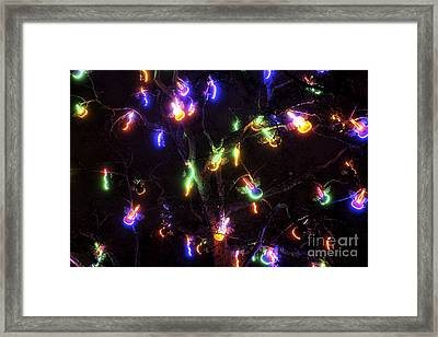 Christmas Violins Framed Print by John Rizzuto