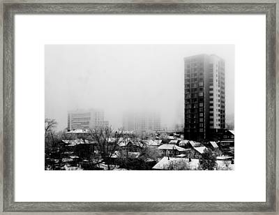 City Apartments Village Homes In Fog Framed Print by John Williams